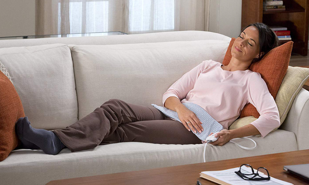 Here's What You Shouldn't Do With A Heating Pad